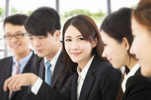 shot of focus on young business woman with colleagues