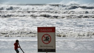 a_sign_informing_the_beach_is_closed_at_burleigh_heads_on_the_gold_coast_aap_2